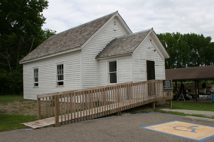 The District #54 country school, built in 1870, was moved into Morristown several years ago to a site next to the old mill along the banks of the Cannon River.