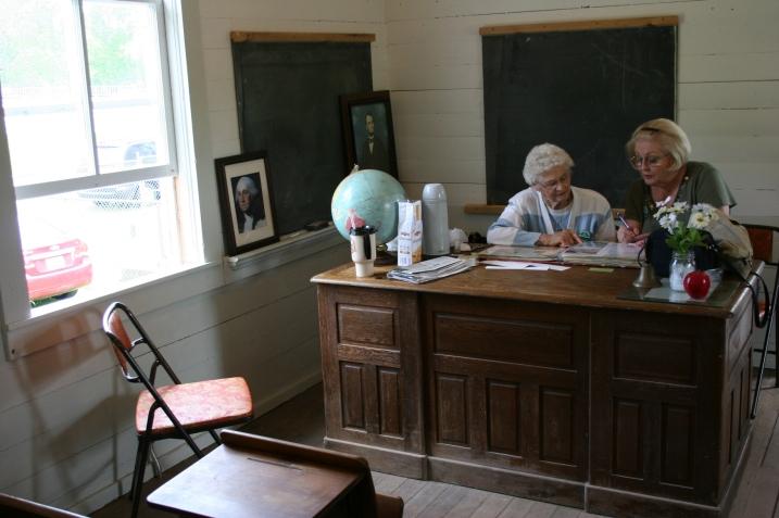 Helen Newman and Cindy Packard work on a sesquicentennial album.