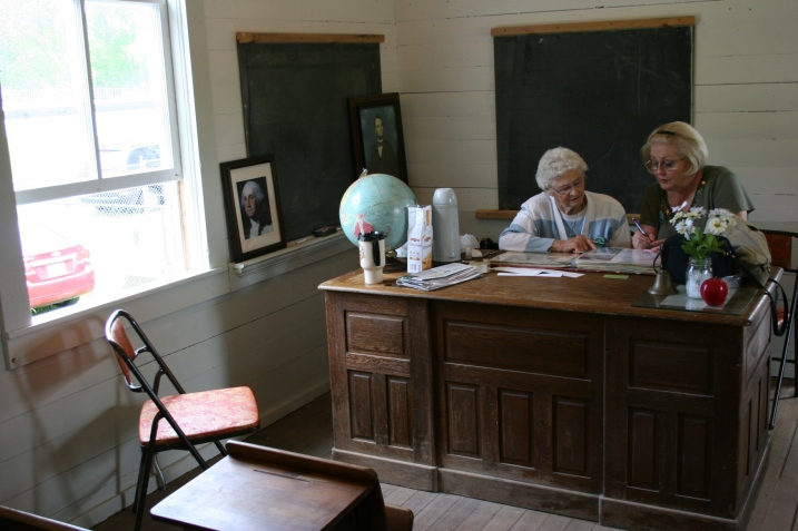 Helen Newman and Cindy Packard work on a sesquicentennial album.