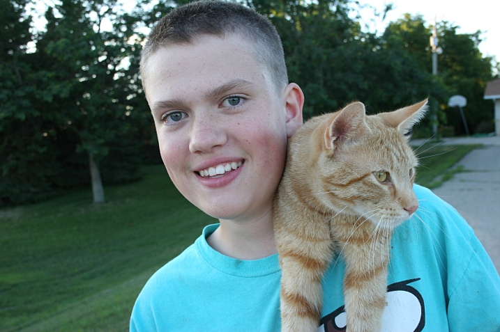 Ian, 14, with the family's cat,