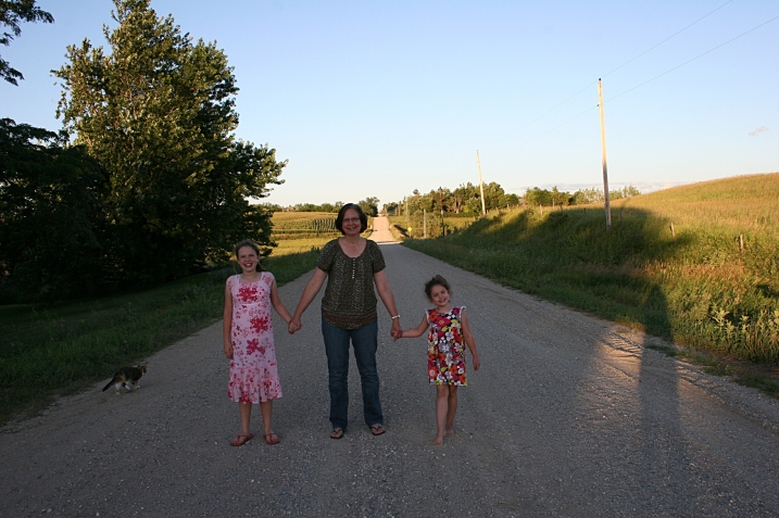 Standing on the state line road with Katie, left, and Lucy.