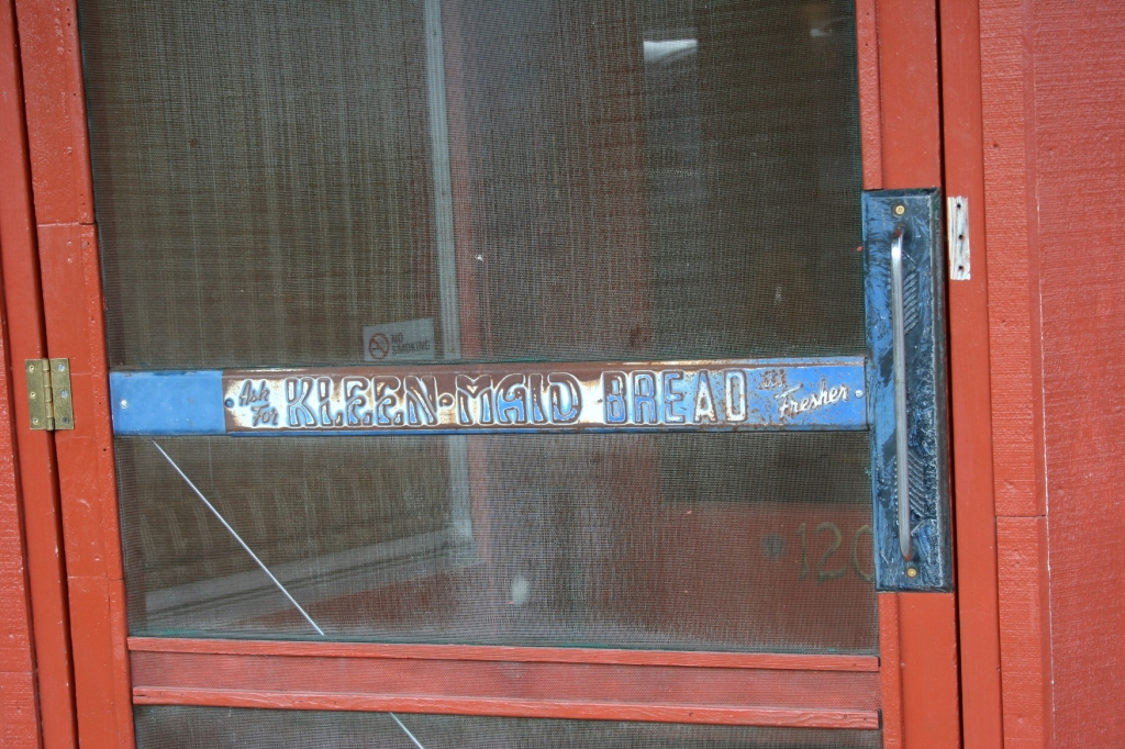 Love this original signage on the old screen door that bangs behind you at