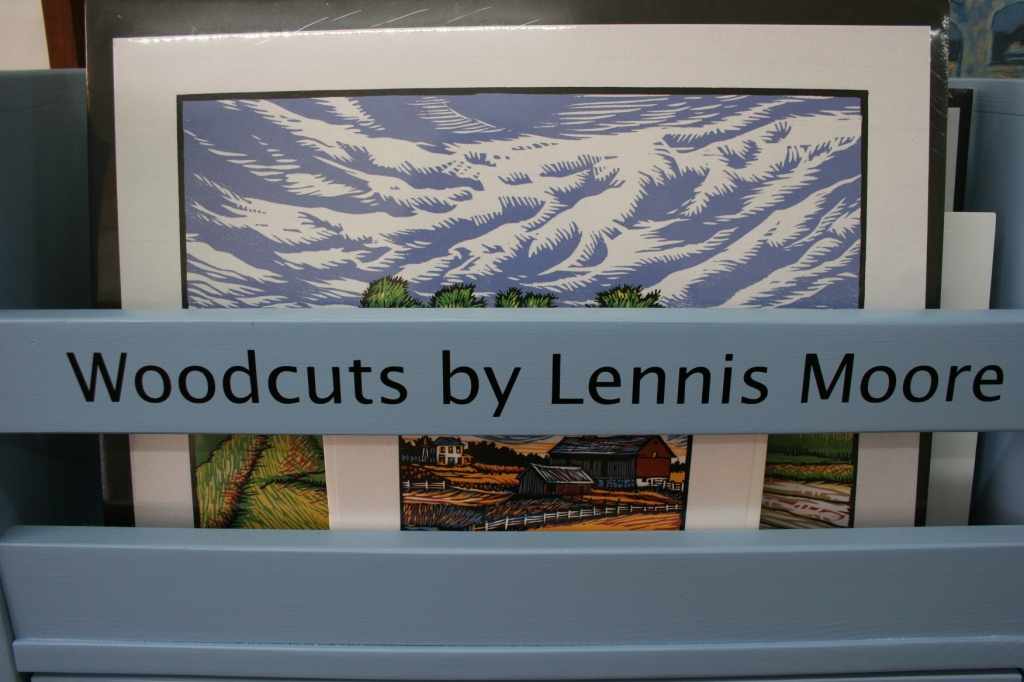 If I had excess discretionary funds, I would have purchased the woodcut art of Lennis Moore sold at Eckheart Gallery.