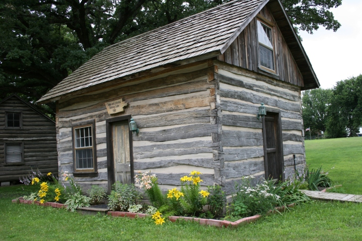 Log cabins on the fairgrounds include this one from 1860 and a replica of an 1839 cabin.