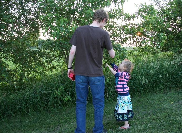 I love this photo of my 19-year-old son, Caleb, picking berries with Ari.