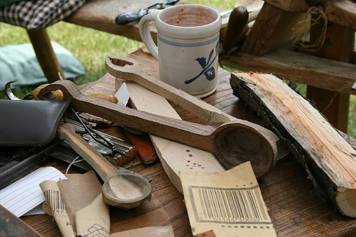 Tools and materials for crafting beautiful wooden spoons.