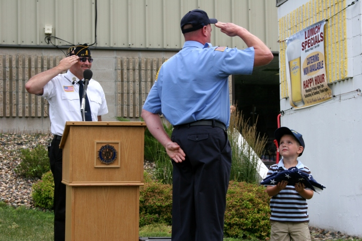Carter accepts the flag for his military family.