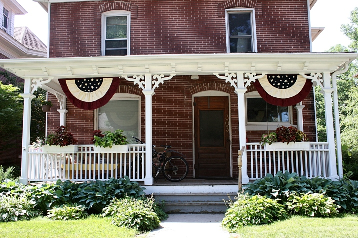 Flag buntings decorate an historic home in the beautiful river town of Decorah, Iowa.