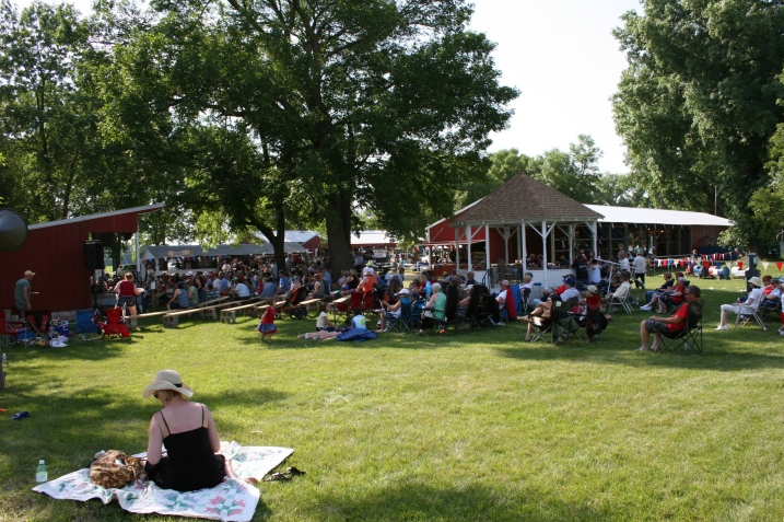 A large crowd enjoys a free afternoon concert by Monroe Crossing.