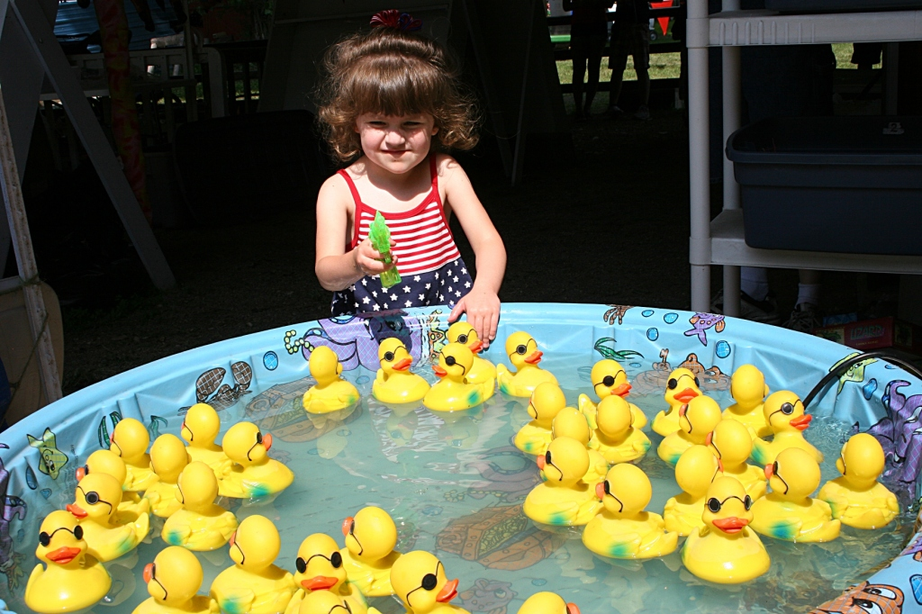 Filling the squirt gun in the duck pond.