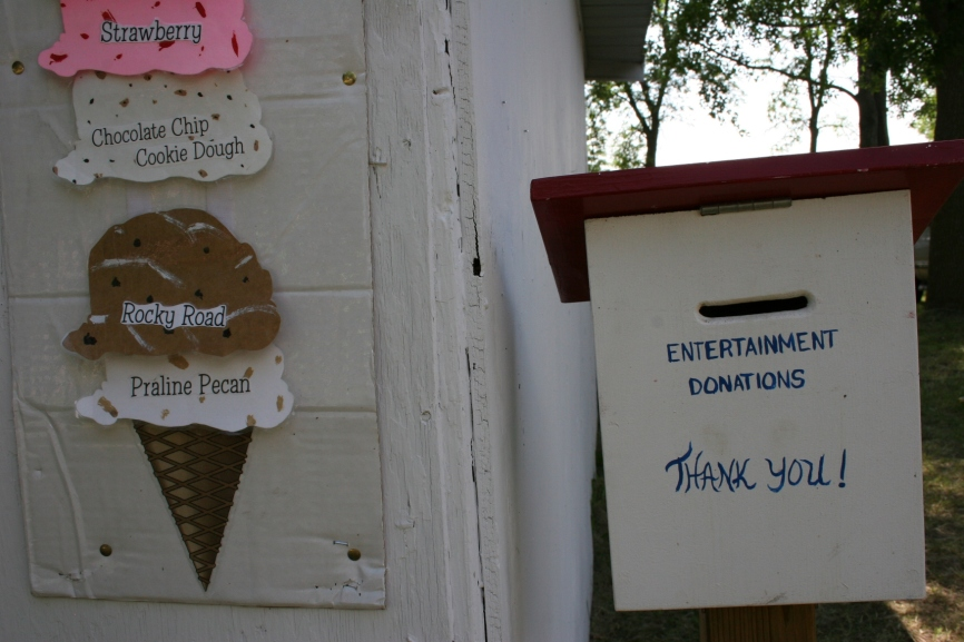 Visitors stopping by the ice cream shop can drop donations for the entertainment into a drop box.