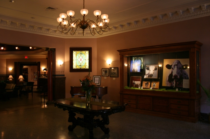The entry features this luxurious lobby and current cow art.