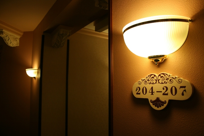 Even the sconces and room signage fit the historic mood.