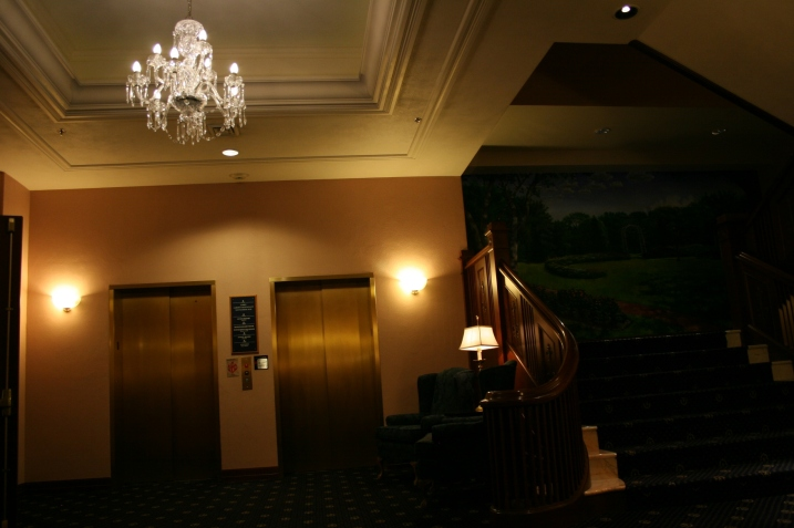 The relocated grand stairway and a mural featuring the gardens on former hotel owner, Chicago philanthropist Helen Basler. Today the hotel is owned by Northfield, Minnesota-based Rebound Hospitality.