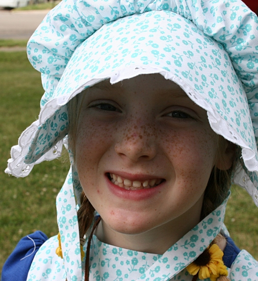 Too young for the Look-A-Like contest, but still outfitted in prairie girl clothing.