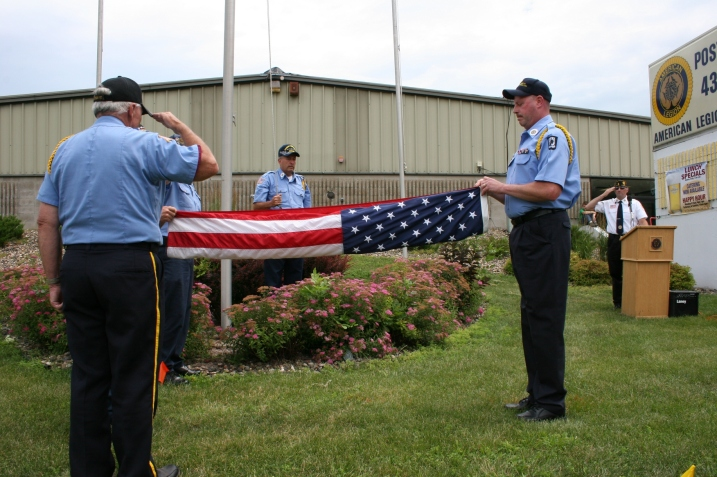 The respectful process begins of properly folding the U.S. flag.