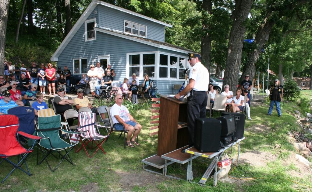 Faribault American Legion Post 43 Commander Kirk Mansfield speaks before the unveiling.