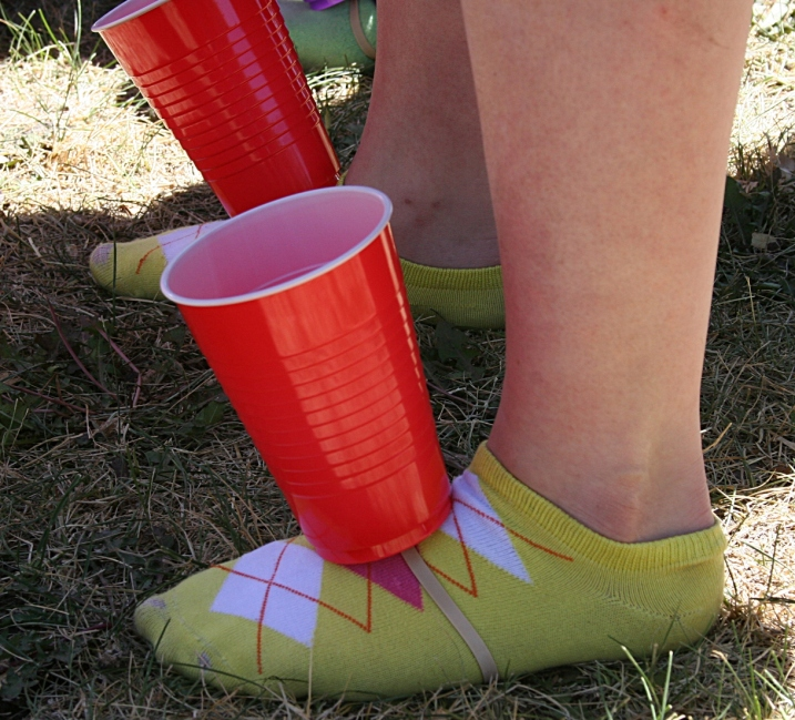 Colorful socks, colorful cups for this contestant in a race to fill the cups with popcorn.
