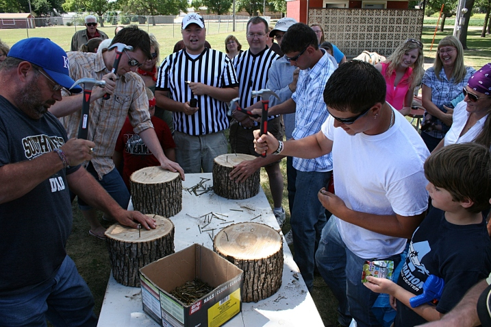 In the nail driving contest, entrants had one minute to pound as many nails as they could into a section of wood.