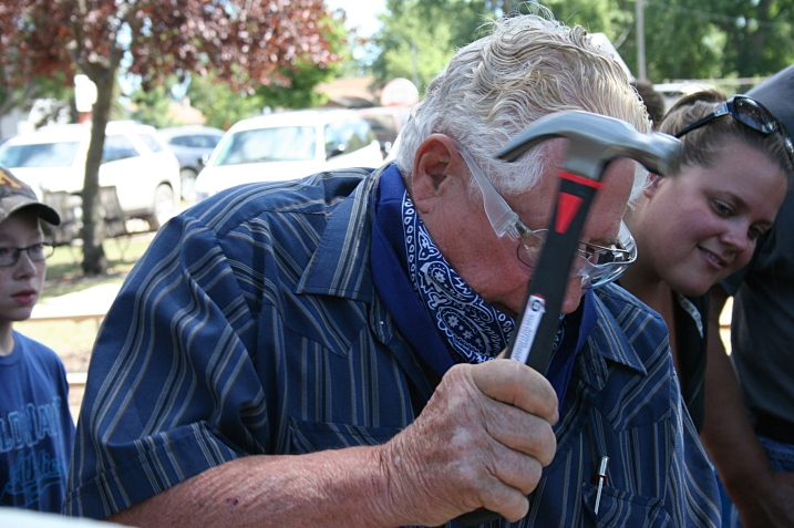 Uncle Wally, an experienced carpenter, won a round of the adult competition in nail driving.