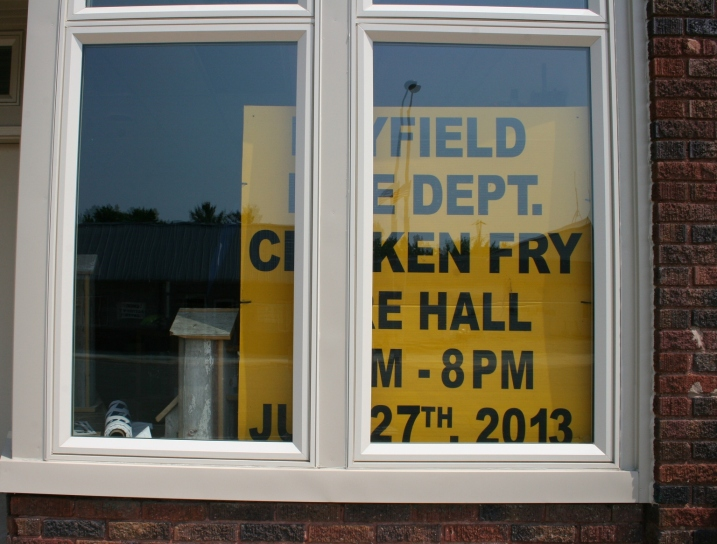 A sign in a window advertises the chicken dinner served during Hey Days.