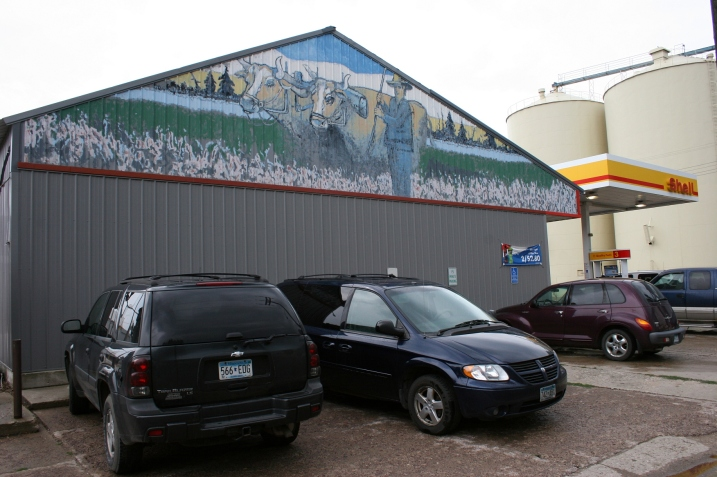 A rural-themed mural on the side of Wayne's C-Store.