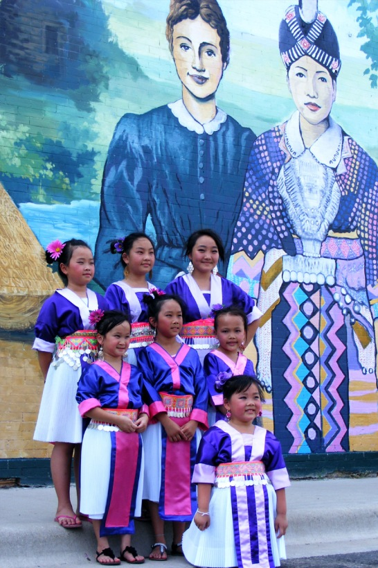Girls in traditional Hmong dress attended the mural dedication last year.