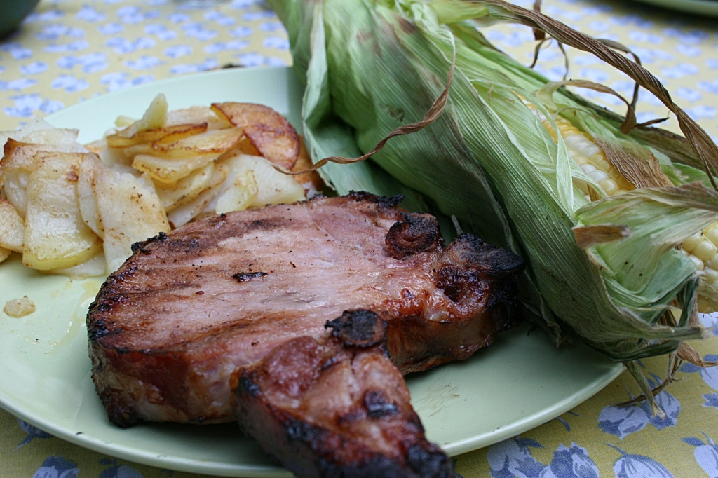 In less than two hours, we were feasting on Bill's sweetcorn; garden fresh potatoes purchased last week from another roadside vendor; and smoked pork chops bought fresh at a local grocery store meat counter.