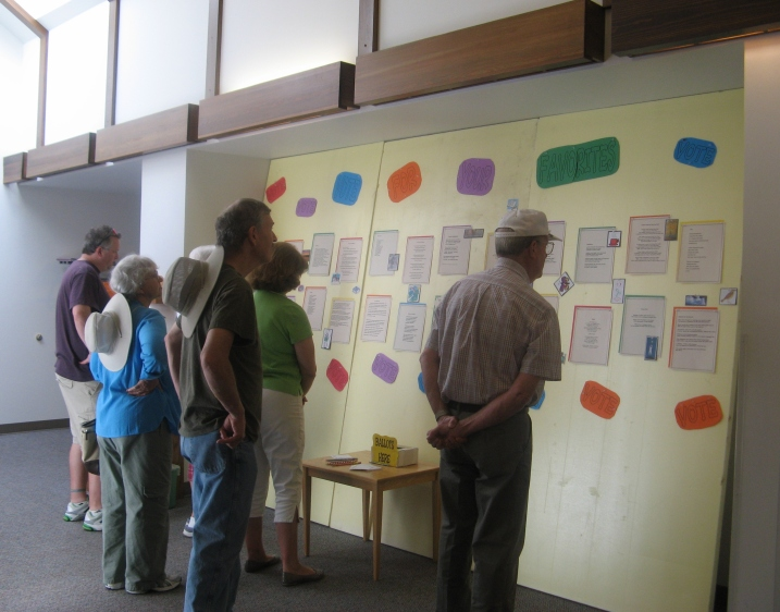 Attendees at the Northwoods Art & Book Festival view showcased poems and then vote for their favorite in the Popular Choice awards.