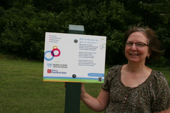 "Me, next to my ""Off to Mankato to 'get and education'"" poem posted near Glenwood Gardens."