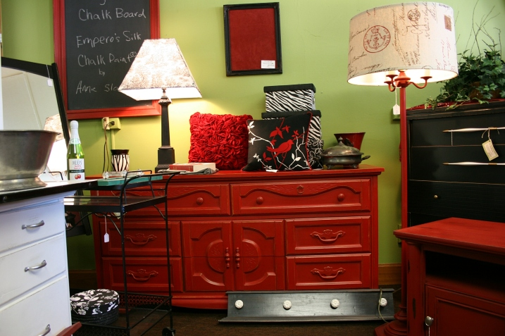 The red dresser/buffet is priced at $295.