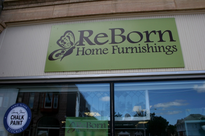 The butterfly on the signage symbolizes the rebirth aspect of transforming old home furnishings in to something new and unique.
