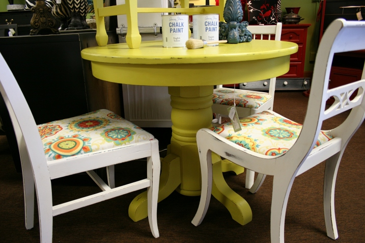 This yellow table can be yours for $160. The chairs are $65/each.
