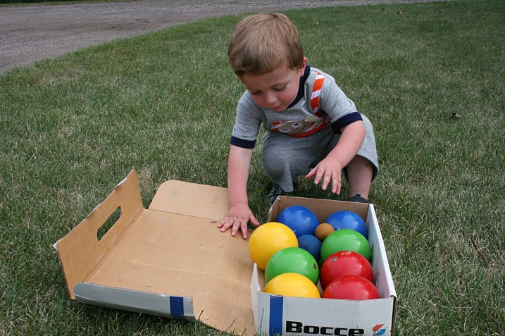 My great nephew Cameron eyes the bocce balls.