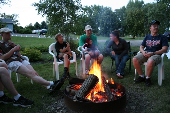 Laughter and conversation around the campfire.