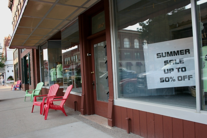 Chairs invite customers and passersby to sit a spell outside St. Clair's for Men and Owatonna Shoe.