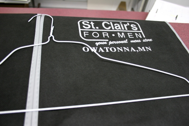 A model business motto imprinted upon a St. Clair's bag.