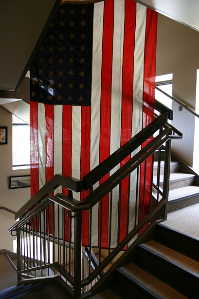 A flag hangs in a hallway outside the military museum.