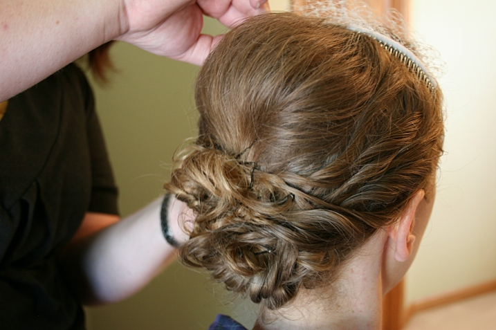 The lovely back of the bride's hair do.