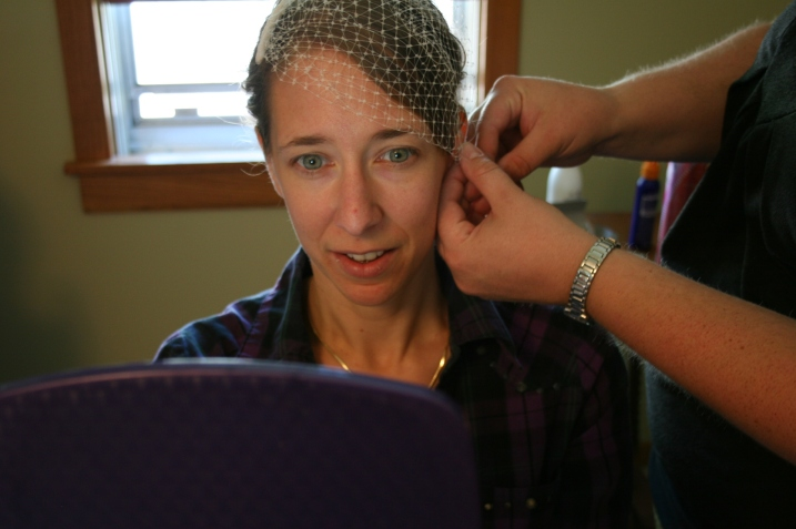 Allie works the veil in to place.