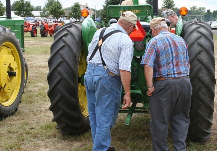 Oh, to overhear this conversation between the wheels of a John Deere tractor.