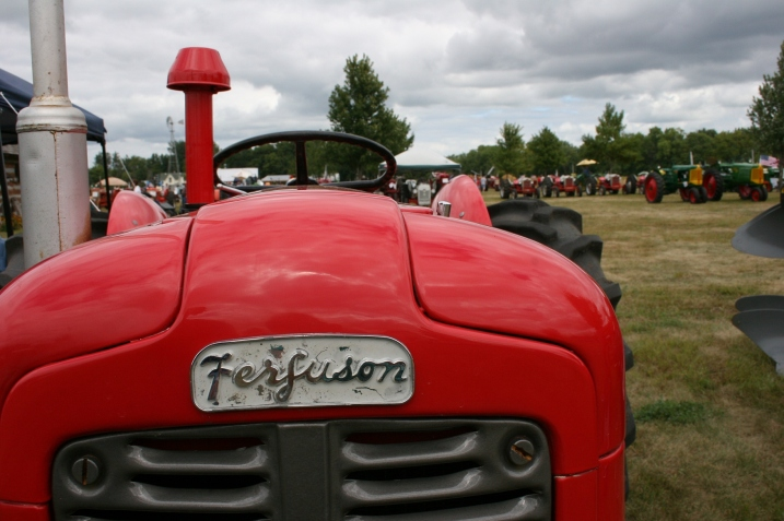 Rows and rows and rows of vintage tractors define this show. For me the interest lies in the artsy aspect of these machines.
