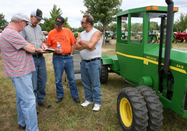 Immersed in tractor talk.