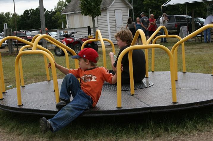 The merry-go-round wheel goes round and round.
