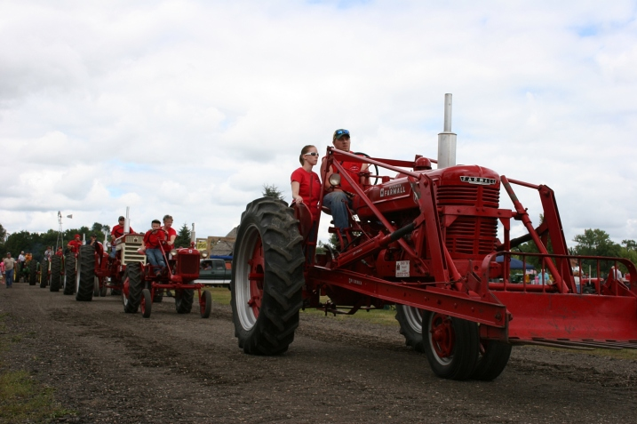 The tractor parade on Sunday afternoon. This year's feature tractor was the Massey-Harris.