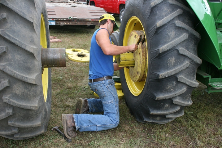 Adding 100-pound wheel weights for the tractor pull.