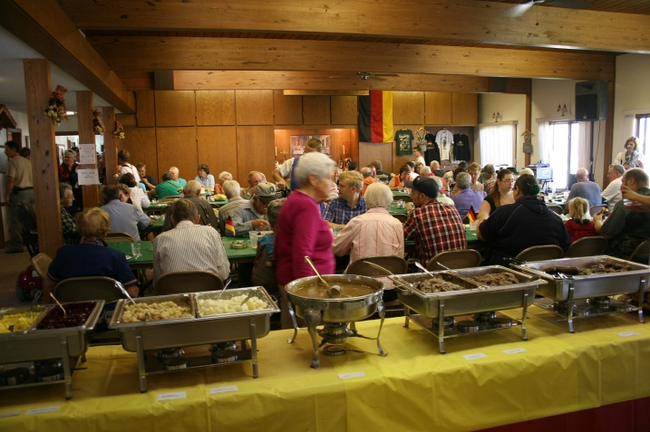 The social hall and rooms off the dining area were filled with diners.