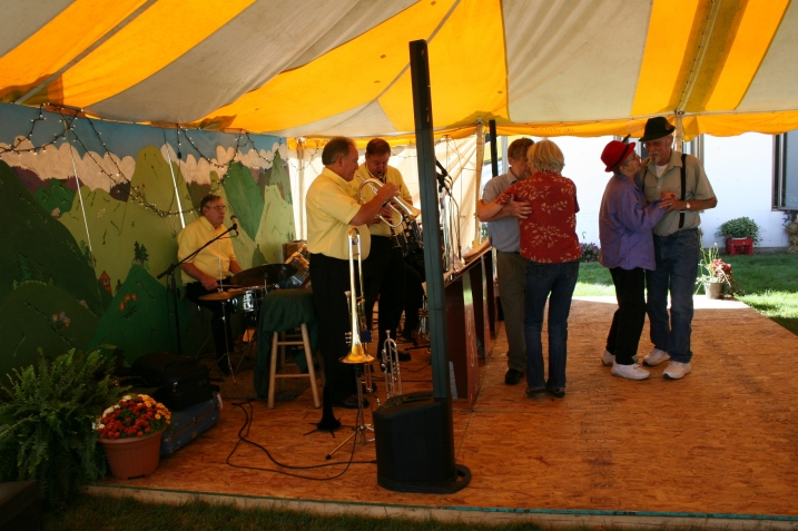 Old-time music drew dancers and listeners to the tent next to the church.