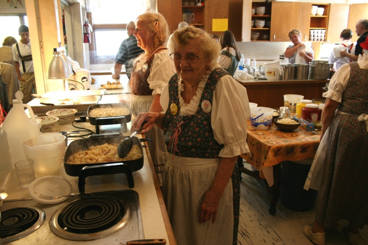 Some of the St. John's kitchen crew, including long-time member Elsie Keller who is making German potato salad.