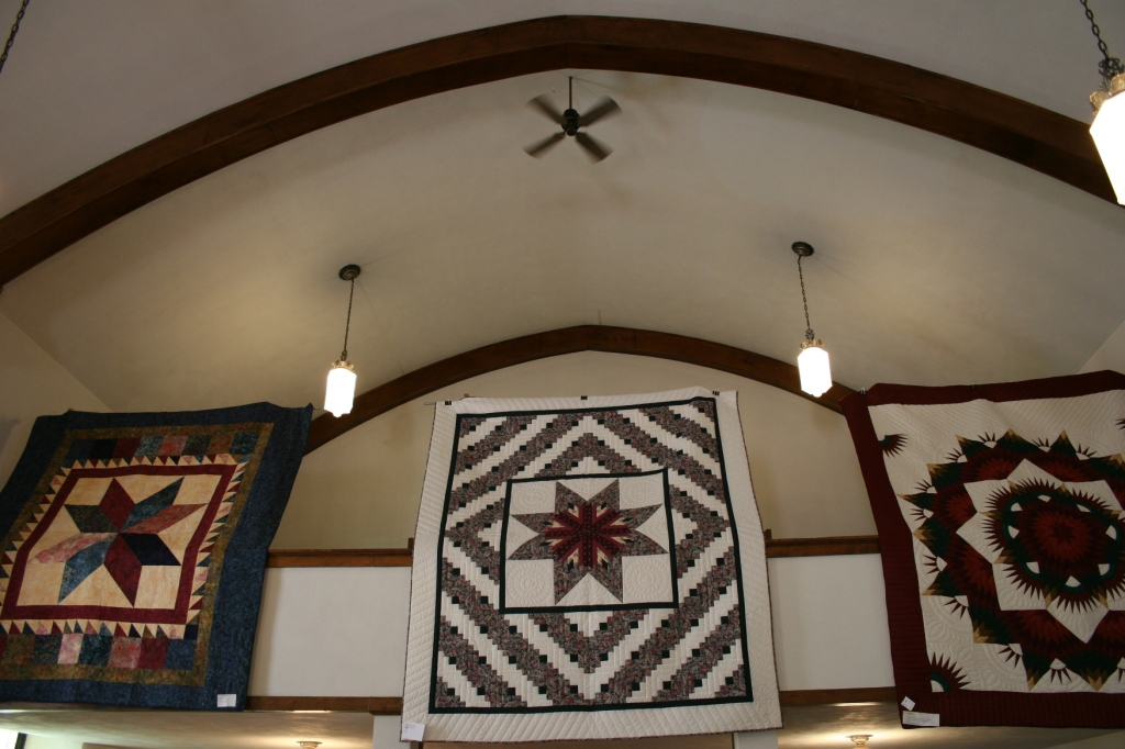 Among the incredible quilts were these three hung from the balcony.